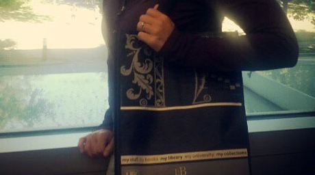 Cropped photo of person with UBC Library bag