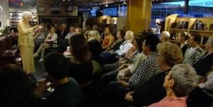 Naomi Beth Wakan reads at a Robson Reading Series event. Photo credit: Robson Reading Series.