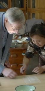 Alvan Bregman learns about traditional book repair.