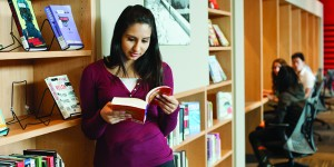 A student enjoys the Great Reads collection at Koerner Library.